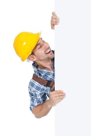 Manual Worker Holding Billboard