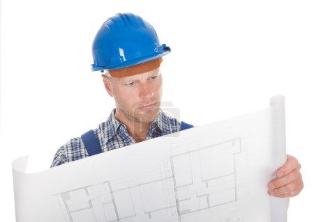 Worker Reading Blueprint