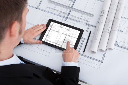 Architect Using Digital Tablet