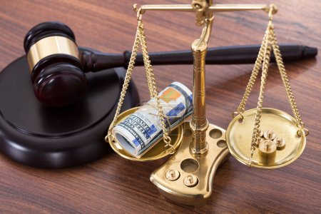 Gavel And Scales With Money
