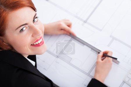 Businesswoman   working on blueprint