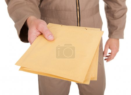 Photo for Midsection of postman holding envelopes over white background - Royalty Free Image