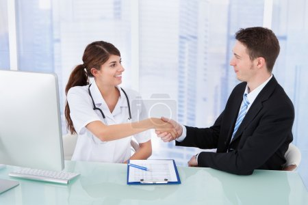 Doctor Greeting Businessman