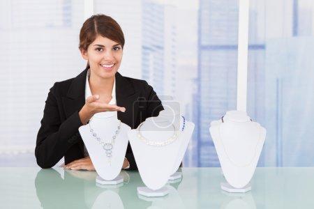 Saleswoman Displaying Jewelry