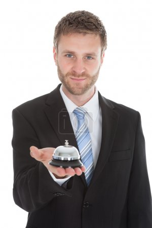 Businessman Holding Service Bell