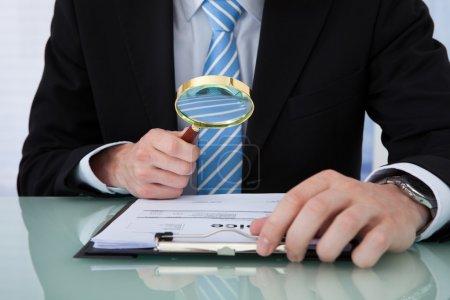 Businessman Examining Invoice