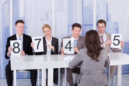 Business People Showing Score Cards