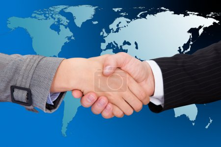 Photo for Cropped image of businessmen shaking hands against world map. - Royalty Free Image