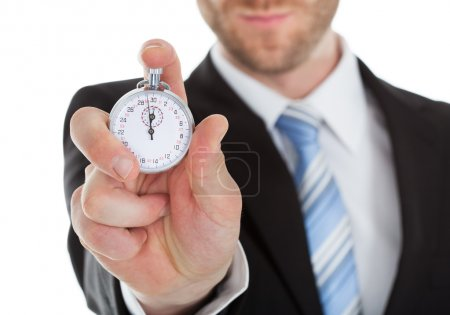 Businessman Showing Stopwatch