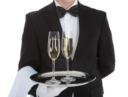 Waiter Carrying Champagne Flutes