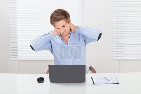 Businessman Having Neck Pain