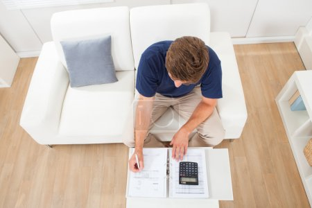 Man Calculating Home Finances
