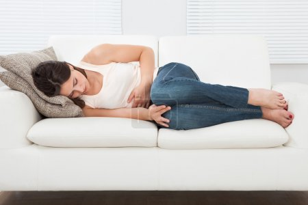 Woman suffering from stomachache
