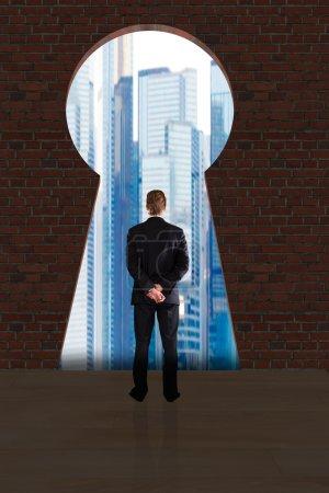Businessman Looking At City Buildings