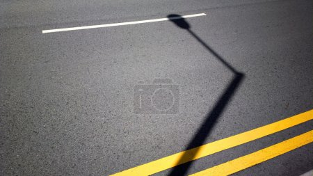 streetlight shadow on road