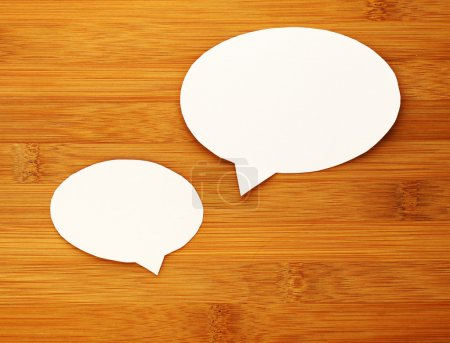 Photo for Paper speech bubble on wood background - Royalty Free Image