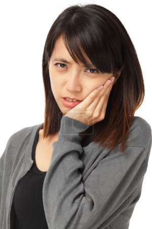 Asian woman with toothache