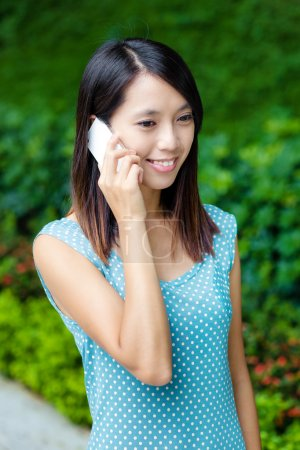 Asian woman talking phone at outdoor