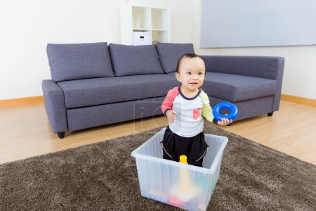 Asian baby boy playing at home