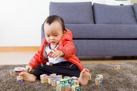 Asian baby playing wooden block