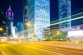 Modern city with car light