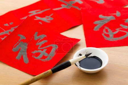 Writing Chinese calligraphy for Chinese new year, word Fu, mean good luck
