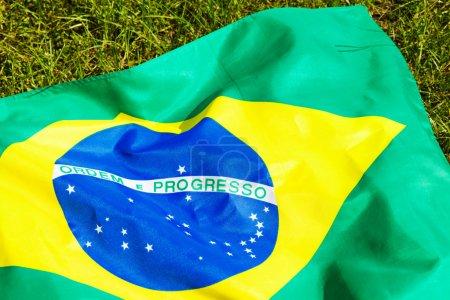 Brazil flag on green glass