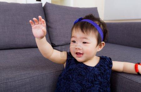 Baby girl waving hand