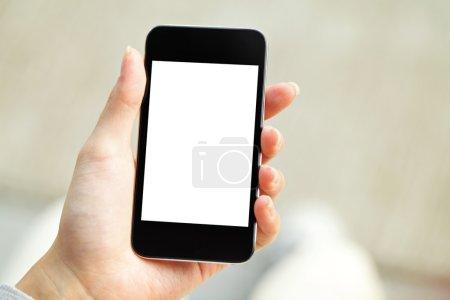 Photo pour Main tenant le téléphone mobile avec écran blanc - image libre de droit