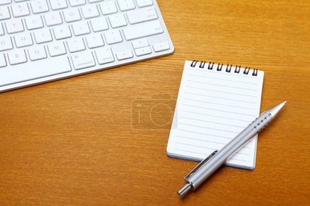 Photo for Notepad and computer keyboard - Royalty Free Image