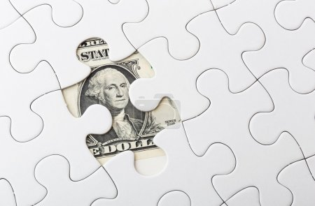 Dollar bill and puzzle piece