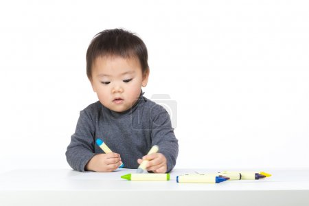 Little boy concentrate on drawing and isolated on white