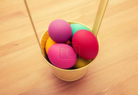 Colourful easter egg in bucket
