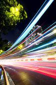 Fast moving car light on street