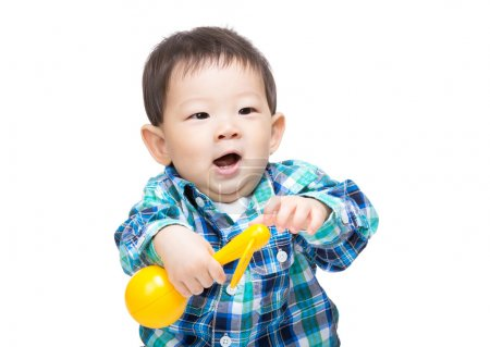 Asian baby boy playing with a  toy