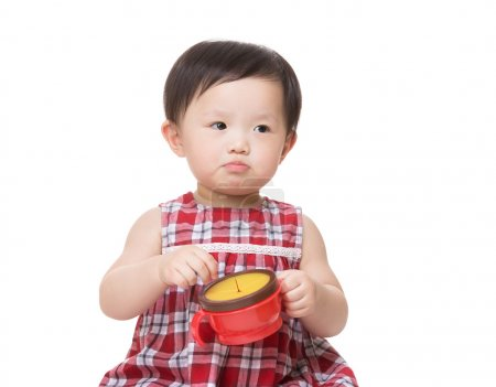 Asian baby girl with snack box