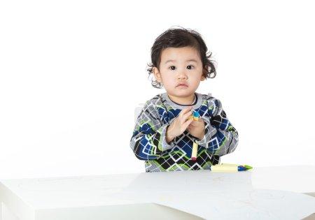 Asian little boy drawing