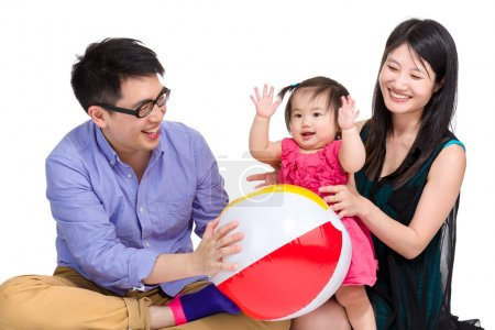 Asian family playing ball