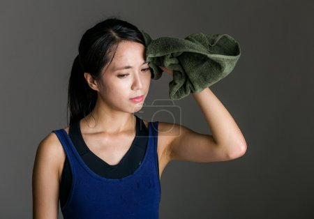 Sport girl wiped by towel