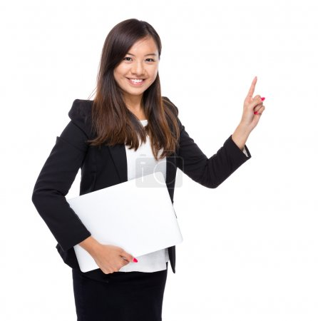 Asian business woman with laptop computer and finger point out