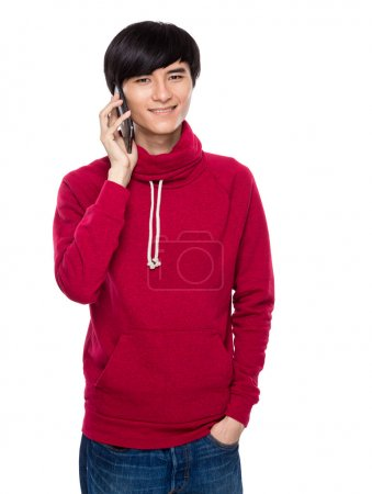 Photo for Asian young man talk to cellphone - Royalty Free Image