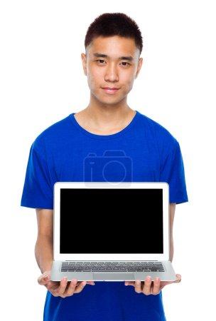 Asian young man show laptop computer