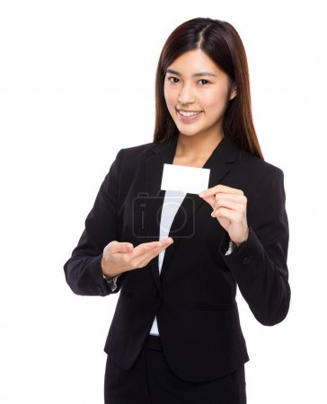 Asian businesswoman present with name card