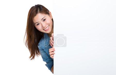 Happy woman hold blank billboard