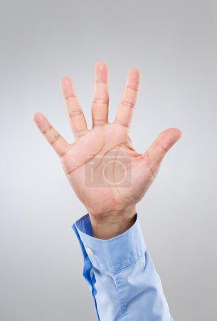 Businessman hand gesture show number five