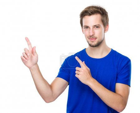 Photo for Young man with two finger point up - Royalty Free Image