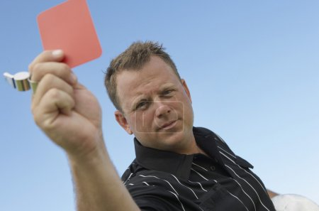 Soccer Referee Assigning Red Card