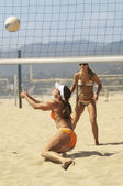 Women Playing Volleyball On Beach