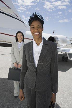 Confident Businesswomen Standing At Airfield