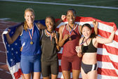 Athletes With American Flag And Medals